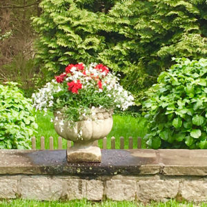 urn bursting with spring flowers trout lily garden design bedford hills ny