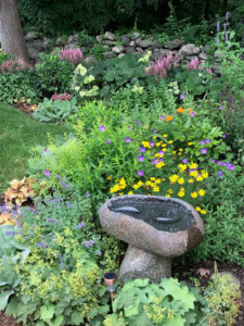 bird bath surrounded by plantings trout lily garden design scarsdale ny