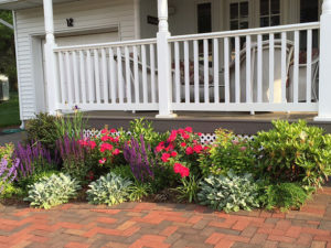 beautiful garden along brick walkway by front porch of house landscaped residential rock garden tiered public garden trout lily garden design pleasantville westchester ny